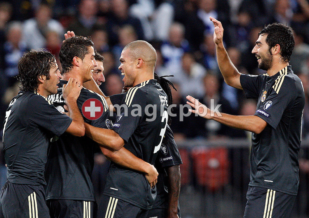 Real Madrid players Raul Gonzalez (L-R), Cristiano Ronaldo, Pepe and Raul Albiol celebrate their second goal during to the UEFA Champions League Group C soccer match between Switzerland's FC Zurich and Spain's Real Madrid at the Letzigrund Stadium in Zurich, Switzerland, Tuesday, Sept. 15, 2009. (Photo by Patrick B. Kraemer / MAGICPBK)