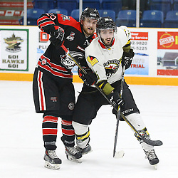 "TRENTON, ON  - MAY 5,  2017: Canadian Junior Hockey League, Central Canadian Jr. ""A"" Championship. The Dudley Hewitt Cup Game 7 between Georgetown Raiders and the Powassan Voodoos.    Jordan Anderson #25 of the Georgetown Raiders battles with Brett Hahkala #18 of the Powassan Voodoos during the second period<br /> (Photo by Alex D'Addese / OJHL Images)"