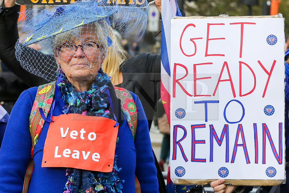 © Licensed to London News Pictures. 30/10/2019. London, UK. A Brexit protester holds a'GET READY TO REMAIN' sign outside Houses of Parliament. On Tuesday 29 October 2019 MPs voted for a UK general election on 12 December 2019. Photo credit: Dinendra Haria/LNP