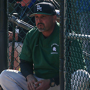 St. Marks Manager Matthew Smith watches the game from the dugout during a regular season baseball game between the St. Marks Spartans and Caravel Academy at St. Marks Stadium Thursday April 14, 2016 in Wilmington.