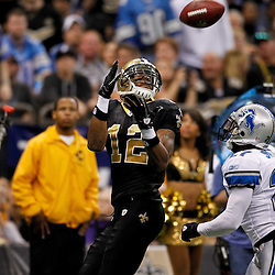 January 7, 2012; New Orleans, LA, USA; New Orleans Saints wide receiver Marques Colston (12) catches a pass over Detroit Lions cornerback Alphonso Smith (27) during the 2011 NFC wild card playoff game at the Mercedes-Benz Superdome. Mandatory Credit: Derick E. Hingle-US PRESSWIRE