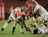 JOHANNESBURG, SOUTH AFRICA - 23 April 2011: Doppies La Grange of the Lions trys to get past Fritz Lee and Liam Messam during the Super Rugby Match between the MTN Lions and the Chiefs held at Coca Cola Park Stadium, Johannesburg, South Africa. Photo by Dominic Barnardt