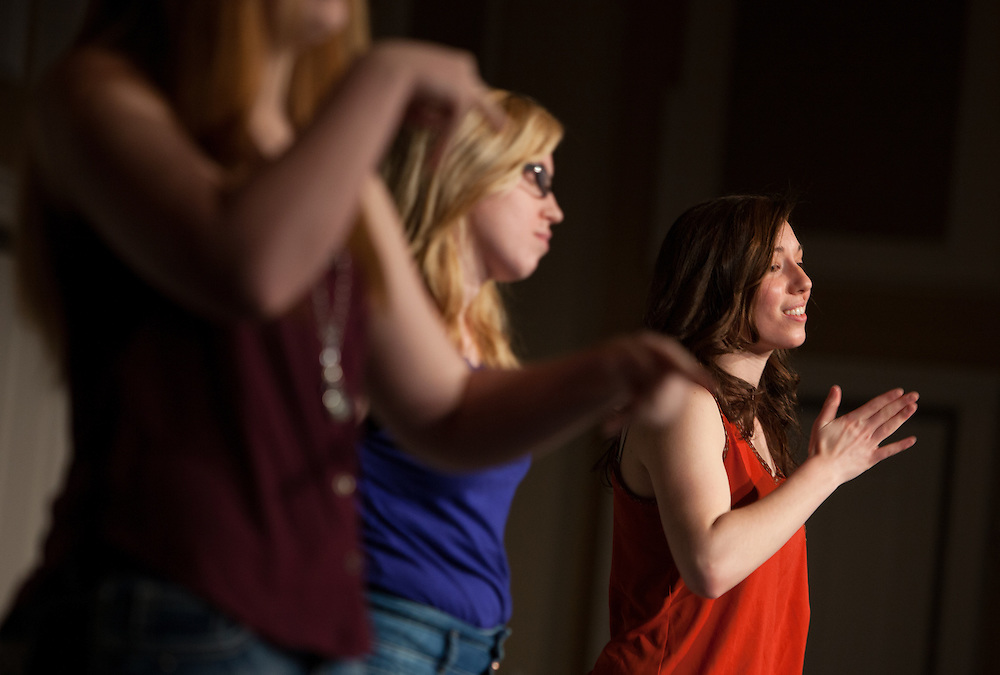 From left: Elizabeth DeLozier, Claire E. Petermann, and Sarah Scarberry do an expressive sign language performance at the beginning of the Sixth Annual International Women's Day Festival, held in Baker Center Ballroom on March 16, 2014. The event, sponsored in part by the Ohio University Women's Center, educated audiences about women's progress, celebrated women's achievements, and included numerous performances by female members of the Athens and Ohio University community. International Women's Day itself fell on March 8, 2014. Photo by Lauren Pond