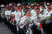 1990s teenage students receive flowers from their parents on the last day of the school term, on 13th June 1990, in Budapest, Hungary. (Photo by Richard Baker / In Pictures via Getty Images)