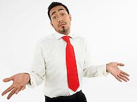 Man shrugging in studio half-length