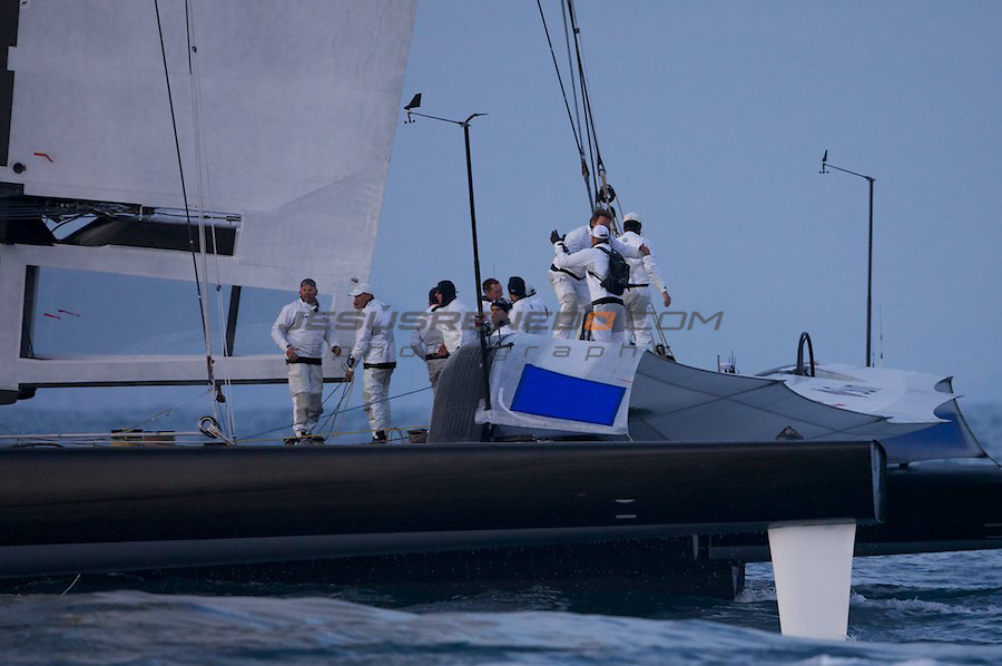 33 americas cup,33 Americas Cup, Oracle giant trimaran with wingsail beats Alinghi Catamaran..Oracle crew celebrating their victory
