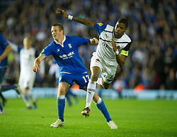 BIRMINGHAM, ENGLAND - Thursday, November 3, 2011: Club Brugge's Keith Fahey clashes with Birmingham City's Adam Rooney during the UEFA Europa League Group H match at St. Andrews. (Pic by David Rawcliffe/Propaganda)