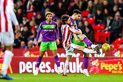 Bailey Wright of Bristol City is challenged by Joe Allen of Stoke City - Rogan/JMP - 01/01/2019 - Bet365 Stadium - Stoke, England - Stoke City v Bristol City - Sky Bet Championship.