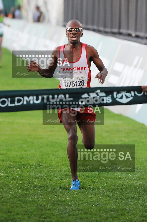 CAPE TOWN, South Africa - Saturday 30 March 2013, Stephen Lesego Mokoka coming in first during the half marathon of the Old Mutual Two Oceans Marathon. .Photo by Roger Sedres/ ImageSA