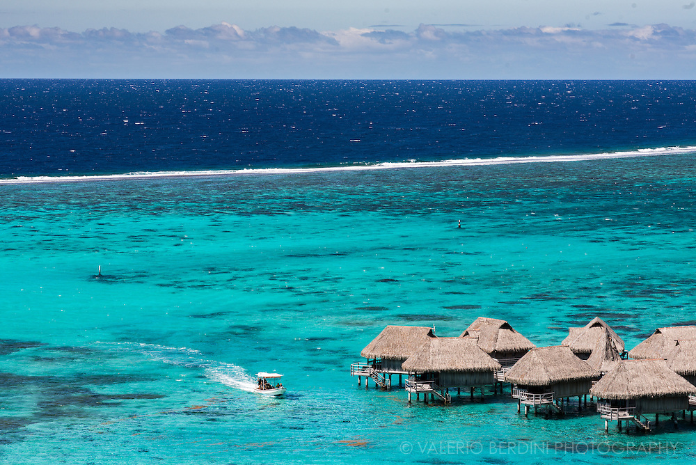 A luxury resort in Moorea with bungalows built on stilt house over the crystalline lagoon waters.