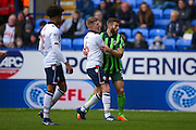 Bolton Wanderers midfielder Josh Vela (6)  is held by AFC Wimbledon defender Jonathan Meades (3)  during the EFL Sky Bet League 1 match between Bolton Wanderers and AFC Wimbledon at the Macron Stadium, Bolton, England on 4 March 2017. Photo by Simon Davies.