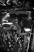 A Teenage rock fan jumping off a balcony into the crowd, Australia 2000's