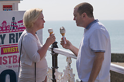 © Licensed to London News Pictures. 06/04/2017. Brighton, UK. Members of the public enjoy an ice-cream in Brighton as sunny and warm weather is hitting the seaside resort. Photo credit: Hugo Michiels/LNP
