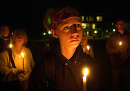 """EWING, NJ - MARCH 27: Heather McConnell, of Haworth, New Jersey holds a lit candle as she participates in an anti-war protest after a """"teach-in"""" at the College of New Jersey, March 27, 2003, in Ewing, New Jersey. The college held the """"teach-in"""" to help students at the college better understand the conflict in Iraq, after which students held the anti-war protest. The protesters contend that the recent polls stating 70 percent of Americans support military action in Iraq is not true. (Photo by William Thomas Cain/Getty Images)"""