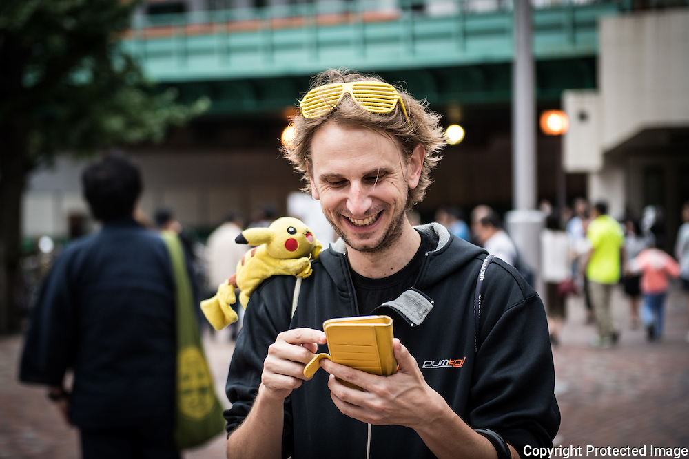 A French fan of Pokemon in Shinjuku. He walked 12 km today for capturing the maximum of pokemons as he could. The Japanese version of the game app Pokemon Go was released on July 22, 2016. Japan McDonalds' 3,000 restaurants in Japan will be turned into Pokemon gyms in collaboration with the fast-food chain. 22/07/2016-Tokyo, JAPAN