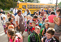 Principal Tara Beauchemin welcomes back 1st and 2nd graders at Elm Street School on Tuesday morning.  (Karen Bobotas/for the Laconia Daily Sun)