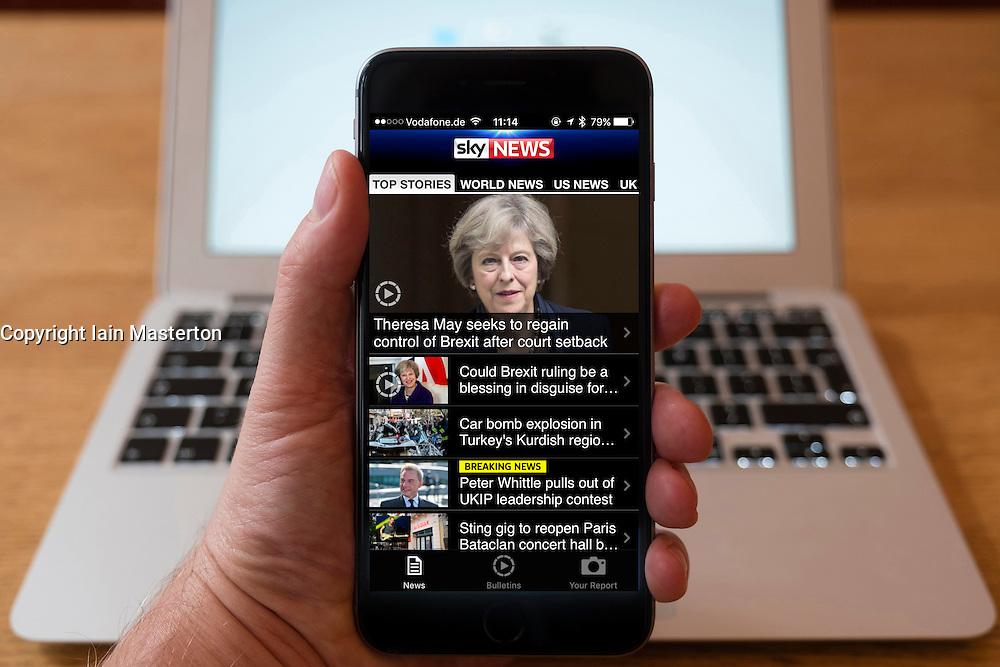 Using iPhone smartphone to display homepage headlines from SKY news app