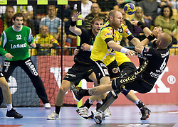 Ales Pajovic (#8) of Celje vs Grzegorz Tkaczyk (#6) of RNL during Velux EHL Champions league 2010/2011 Group A men handball match between HC Celje Pivovarna Lasko of Slovenia and Rhein-Neckar Loewen of Germany, on October 2, 2010 in Arena Zlatorog, Celje, Slovenia. Rhein-Neckar Löwen defeated Celje Pivovarna Lasko 32 - 28. (Photo By Vid Ponikvar / Sportida.com)