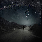 Surreal nightscape with stars forming the form of a person - manipulated photograph<br /> Redbubble products: http://www.redbubble.com/people/dyrkwyst/works/19920812-starman