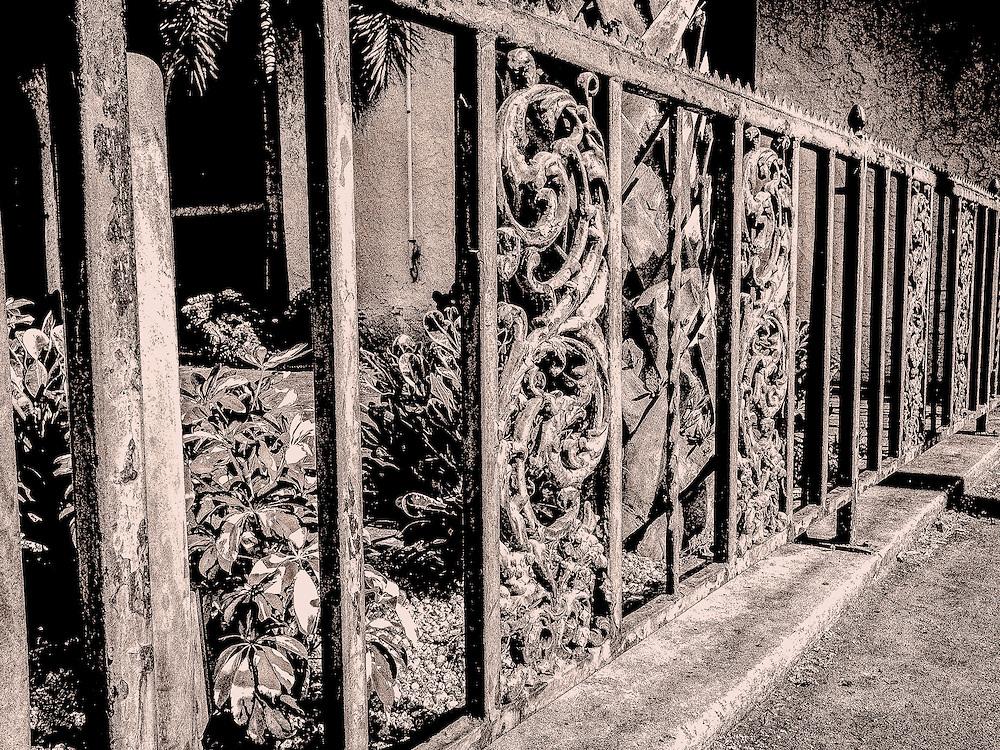 Iron fence, sepia, Ybor City (Tampa), Florida. Photo by Richard M. Porter