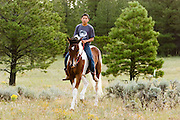 "09 SEPTEMBER 2007 -- ST. MICHAELS, AZ: CONRAD WHITEHORSE, from Many Farms, AZ, rides ""Buster"" before a traditional Navajo Horse Race in the summit area of the Navajo Indian reservation about 10 miles west of St. Michaels, AZ. Traditional horse racing is making a comeback on the Navajo reservation. The races are run on improvised courses that vary depending on the local terrain. Use of saddles is optional (except in the ""Cowhand Race"" which requires a western style saddle) and many jockeys ride bareback. The distances vary from one mile to as long as thirty miles. Traditional horse races were common until the 1950's when they fell out of favor, but there has been a resurgence in traditional racing since the late 1990's and now there is a traditional horse racing circuit on the reservation.  The race was organized by the Begay family of Steamboat, AZ and run on private land about three miles from a paved road.   Photo by Jack Kurtz / ZUMA Press"