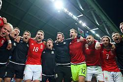 LILLE, FRANCE - Friday, July 1, 2016: Wales players celebrate in the team huddle following a 3-1 victory over Belgium and reaching the Semi-Final during the UEFA Euro 2016 Championship Quarter-Final match at the Stade Pierre Mauroy. Adam Owen, Sam Vokes, physiotherapist David Weeks, Ronan Kavanagh, goalkeeper Owain Fon Williams, Ashley 'Jazz' Richards, Joe Allen, head of performance Ryland Morgans. (Pic by David Rawcliffe/Propaganda)