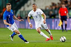 Kieran Gibbs of England is challenged by Ignazio Abate of Italy - Photo mandatory by-line: Rogan Thomson/JMP - 07966 386802 - 31/03/2015 - SPORT - FOOTBALL - Turin, Italy - Juventus Stadium - Italy v England - FIFA International Friendly Match.