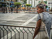 18 AUGUST 2015 - BANGKOK, THAILAND:     A Thai man looks at the damaged Erawan Shrine Tuesday. An explosion at Erawan Shrine, a popular tourist attraction and important religious shrine in the heart of the Bangkok shopping district, killed at least 20 people and injured more than 120 others, including foreign tourists, during the Monday evening rush hour. Twelve of the dead were killed at the scene. Thai police said an Improvised Explosive Device (IED) was detonated at 18.55. Police said the bomb was made of more than six pounds of explosives stuffed in a pipe and wrapped with white cloth. Its destructive radius was estimated at 100 meters.PHOTO BY JACK KURTZ