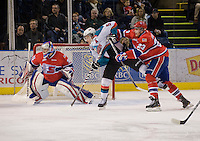 KELOWNA, CANADA, DECEMBER 27: Mitch Chapman #5 of the Kelowna Rockets is checked by Corbin Baldwin #23 of the Spokane Chiefs at the Kelowna Rockets on December 7, 2011 at Prospera Place in Kelowna, British Columbia, Canada (Photo by Marissa Baecker/Getty Images) *** Local Caption ***