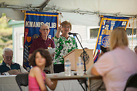 Jenny Nelson reads a letter from Senator Bernie Sanders during the 70th Anniversary celebration of the Kiwanis Pool in St. Johnsbury Vermont.  Karen Bobotas / for Kiwanis International