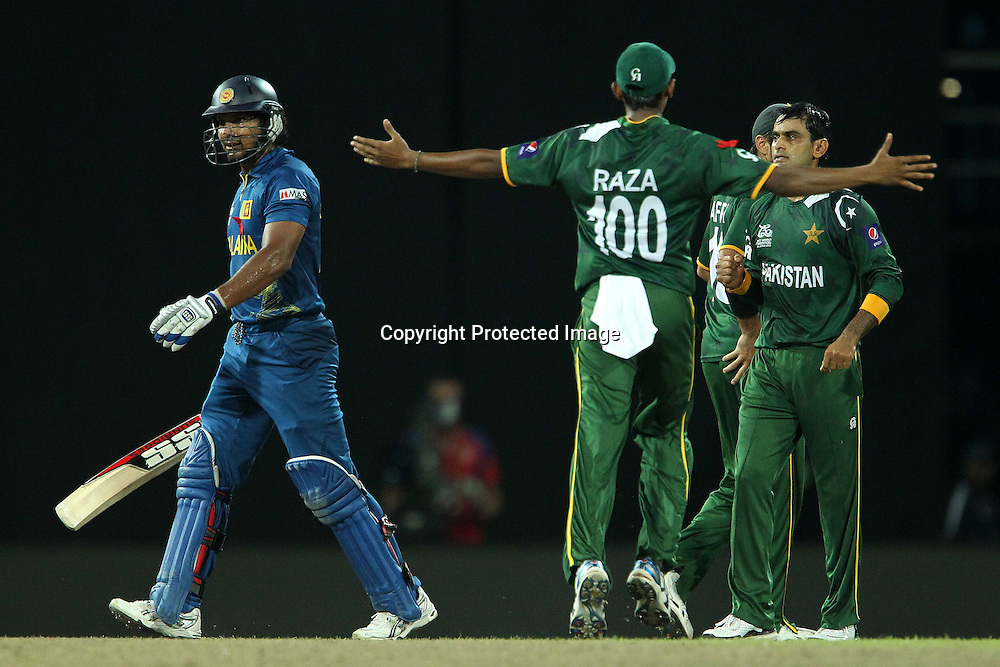 Raza Hasan and Mohammad Hafeez celebrates the wicket of Kumar Sangakkara as he departs during the ICC World Twenty20 semi final match between Sri Lanka and Pakistan held at the Premadasa Stadium in Colombo, Sri Lanka on the 4th October 2012<br /> <br /> Photo by Ron Gaunt/SPORTZPICS