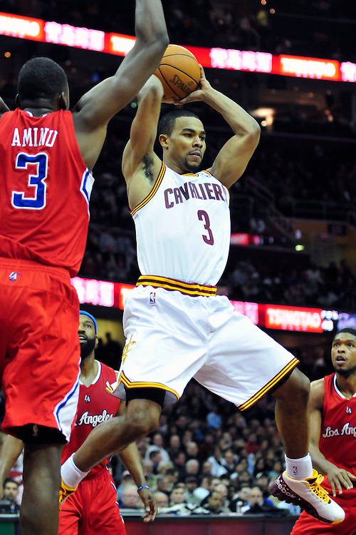 Feb. 11, 2011; Cleveland, OH, USA; Cleveland Cavaliers point guard Ramon Sessions (3) passes around Los Angeles Clippers small forward Al-Farouq Aminu (3) during the second quarter at Quicken Loans Arena. Mandatory Credit: Jason Miller-US PRESSWIRE