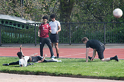 © Licensed to London News Pictures. 08/04/2020. London, UK. A group of young men exercising on Hampstead Heath, North London, during a pandemic outbreak of the Coronavirus COVID-19 disease. The public have been told they can only leave their homes when absolutely essential, in an attempt to fight the spread of coronavirus COVID-19 disease. Photo credit: Ben Cawthra/LNP