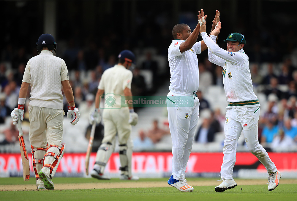South Africa's Vernon Philander (centre right) celebrates England's Joe Root being caught out during day one of the 3rd Investec Test match at the Kia Oval, London.