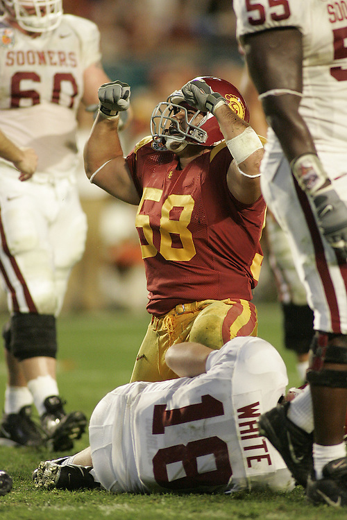 University of Southern California linebacker Lofa Tatupu tackles Oklahoma University quarterback Jason White during USC's 55-19 victory over Oklahoma on January 4, 2005 in the FedEx Orange Bowl at Pro Player Stadium in Miami, Florida.