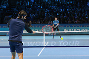 Novak Djokovic faces a return forehand during the final of the ATP World Tour Finals between Roger Federer of Switzerland and Novak Djokovic at the O2 Arena, London, United Kingdom on 22 November 2015. Photo by Phil Duncan.