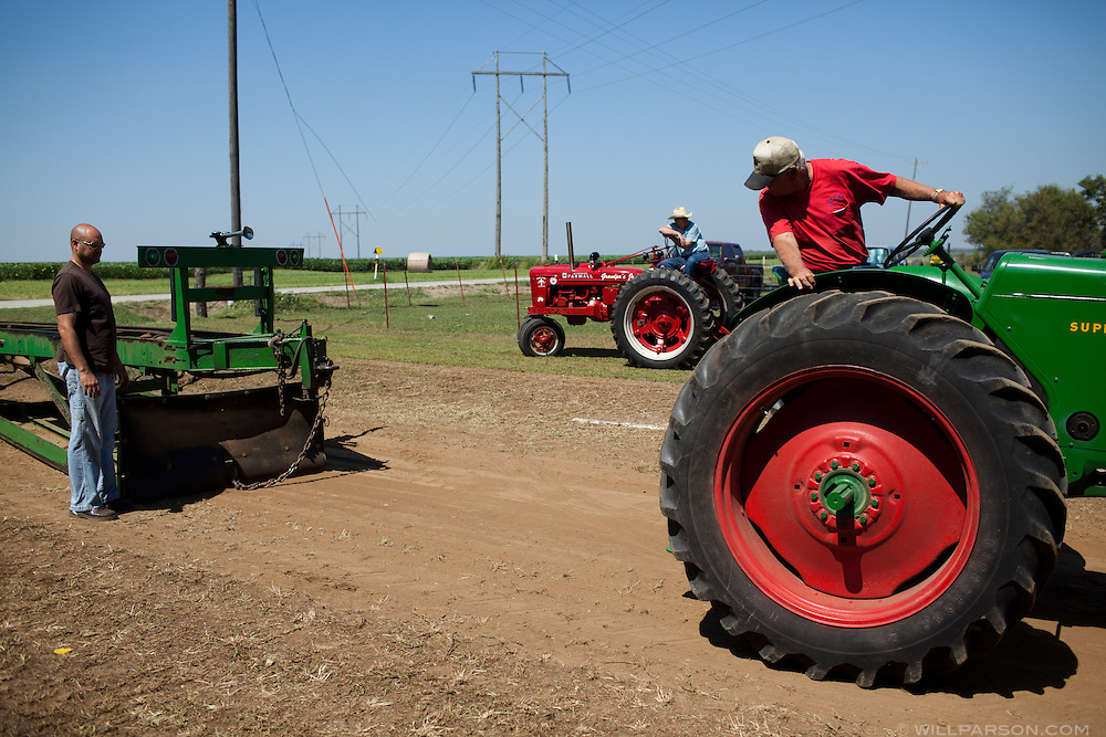 A driver prepares for a run during a tractor pull in Girard, Kansas, Sep. 6, 2010.