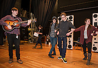"Dan Pinkham-Breslin, Daniel Kehr, Cameron Doyle and Marissa Leyland rehearse a scene from ""A Fever Dream of Creativity"" a student run improv and sketch show with the Players Comedy Club at Winnisquam Regional High School on Wednesday afternoon.  (Karen Bobotas/for the Laconia Daily Sun)"