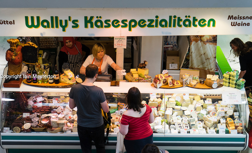 Cheese shop inside Marheineke Markthale market on Bergmannstrasse in Kreuzberg Berlin Germany