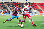 Scunthorpe United Midfielder Duane Holmes (19) on the attack Doncaster Rovers Defender Harry Toffolo (18) keeps the pressure on during the The FA Cup match between Doncaster Rovers and Scunthorpe United at the Keepmoat Stadium, Doncaster, England on 3 December 2017. Photo by Craig Zadoroznyj.