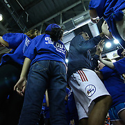 "Delaware 87ers Forward Norvel Pelle (15) ""CENTER"" returns to the court for the start of the second half a NBA D-league regular season basketball game between the Delaware 87ers (76ers) and the Maine Red Claws (Boston Celtics) while greeted by young fans Friday, March. 21, 2014 at The Bob Carpenter Sports Convocation Center in Newark, DEL"
