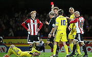 Brentford defender Harlee Dean getting a red card for fouling Nottingham Forest midfielder Jonny Williams during the Sky Bet Championship match between Brentford and Nottingham Forest at Griffin Park, London, England on 21 November 2015. Photo by Matthew Redman.