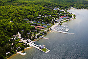 Aerial view of Ephraim, Door County, Wisconsin, with the Hardy Center for the Arts in the lower portion of the photograph on the extended pier.