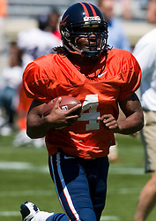 Virginia quarterback Vic Hall (4) warms up for the spring game. The Virginia Cavaliers football team played the annual spring football scrimmage at Scott Stadium on the Grounds of the University of Virginia in Charlottesville, VA on April 18, 2009.  (Special to the Daily Progress / Jason O. Watson)