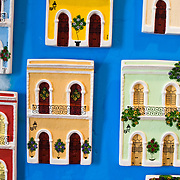 Brightly colored ceramic relief sculptures of store and house fronts cover a wall in a souvenir shop in Old San Juan, Puerto Rico.
