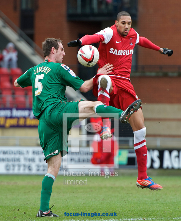 Picture by Alan Stanford/Focus Images Ltd +44 7915 056117.16/03/2013.Shaun Batt of Leyton Orient and Danny Livesey of Carlisle United contest the ball during the npower League 1 match at the Matchroom Stadium, London..