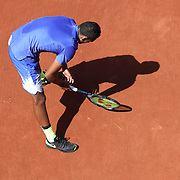 2017 French Open Tennis Tournament - Day Three.  Nick Kyrgios of Australia plays naughts and crosses in the clay as he awaits play after a change of ends during his match against Philipp Kohlschreiber of Germany on court two during the Men's Singles round one match at the 2017 French Open Tennis Tournament at Roland Garros on May 30th, 2017 in Paris, France.  (Photo by Tim Clayton/Corbis via Getty Images)
