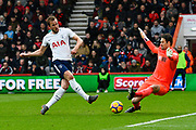 Harry Kane (10) of Tottenham Hotspur beats Asmir Begovic (27) of AFC Bournemouth but his goal is ruled offside and is then injured in the collision which trapped his ankle under the Bournemouth keeper during the Premier League match between Bournemouth and Tottenham Hotspur at the Vitality Stadium, Bournemouth, England on 11 March 2018. Picture by Graham Hunt.