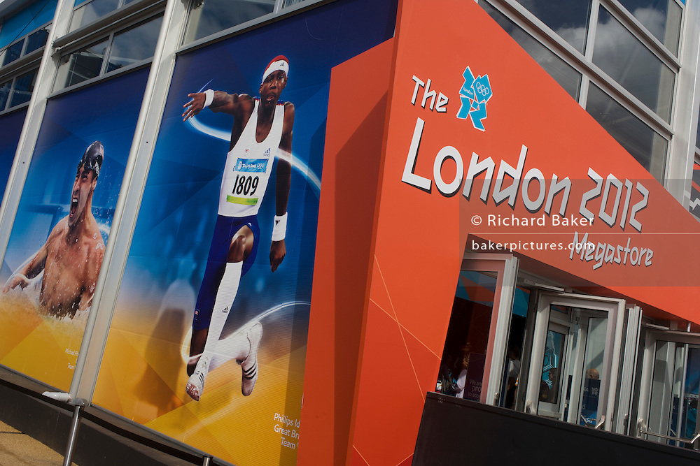 With images of Olympian athletes such as swimmer Michael Phelps and long jumper Phillips Idowu, an exterior of the Olympic Megastore in the Olympic Park during the London 2012 Olympics. This land was transformed to become a 2.5 Sq Km sporting complex, once industrial businesses and now the venue of eight venues including the main arena, Aquatics Centre and Velodrome plus the athletes' Olympic Village. After the Olympics, the park is to be known as Queen Elizabeth Olympic Park.