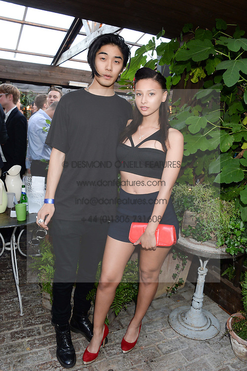 TOMO KURATA and LEAH WELLER attending the Warner Bros. & Esquire Summer Party held at Shoreditch House, Ebor Street, London E1 on 18th July 2013.